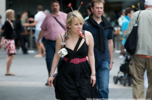 A woman wearing bouncy head-boppers, looking curious.